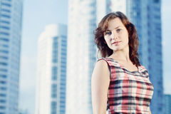 Young caucasian woman standing in city looking at camera. Royalty Free Stock Images