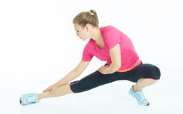 Young caucasian woman stretching legs warm up. Stock Photos