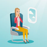 Young caucasian woman suffering from aerophobia. Stock Image