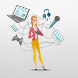 Young caucasian woman surrounded by her gadgets. Caucasian woman taking photo with digital camera. Woman surrounded by her gadgets. Woman using many electronic Royalty Free Stock Photos