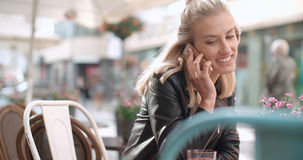Young caucasian woman talking on phone in a city. Stock Images