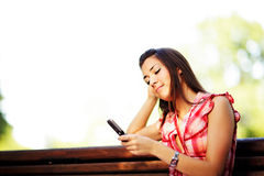 Young caucasian woman texting on cell phone. Royalty Free Stock Image