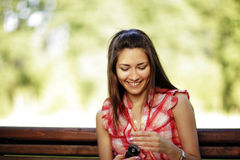 Young caucasian woman texting on cell phone. Stock Photos