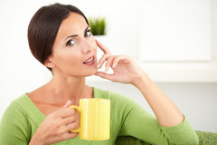 Young caucasian woman touching her chin Royalty Free Stock Photography