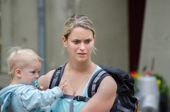 Young caucasian woman tourist with her little son at Bern, Switzerland royalty free stock photography