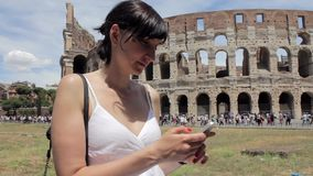 Young caucasian woman tourist texting on beautiful view of european ancient city with mobile smart phone stock video footage