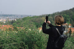 Travelling woman taking photo with cellphone Royalty Free Stock Images