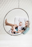 Young Caucasian woman with two babies having fun Stock Photography