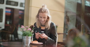 Young caucasian woman typing on phone in a city. stock footage