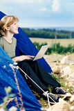 Young Caucasian woman using Laptop on nature. Royalty Free Stock Photos