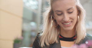 Young caucasian woman using phone in a city. stock video