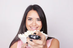 Young caucasian woman watching a movie / TV Royalty Free Stock Images
