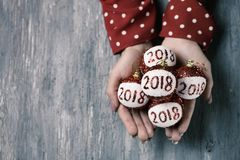 Woman with christmas balls with the number 2018 Stock Image