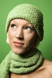 Young Caucasian woman wearing winter hat and scarf. Royalty Free Stock Photography