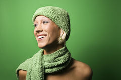 Young Caucasian woman wearing winter hat and scarf. Royalty Free Stock Photos