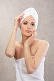 A young Caucasian woman in a white cotton towel Royalty Free Stock Image