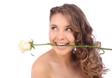 Young caucasian woman with a white rose in her mouth Royalty Free Stock Photography