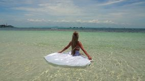 Young Caucasian Woman in White Skirt Bathing in Tropical Turquoise Sea stock footage