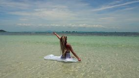 Young Caucasian Woman in White Skirt Bathing in Tropical Turquoise Sea stock video footage