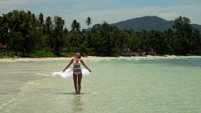 Young Caucasian Woman in White Skirt Walking on Tropical Sandy Beach stock footage