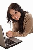Young caucasian woman working on laptop Royalty Free Stock Photography