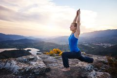 Young Caucasian woman working out on a rock Stock Photo