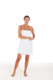 Young Caucasian woman wrapped in bath towel. Standing Stock Photography