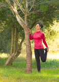 Young caucasian women doing stretching exercising outdoors Stock Images