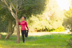 Young caucasian women doing stretching exercising outdoors Stock Photography