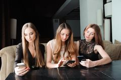 Young caucasian women using phone and saying no to life. Smartphone addiction concept. royalty free stock photos