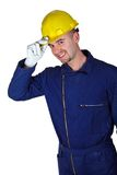 Young caucasian worker heavy industry. Background Stock Image