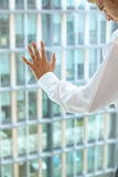 Young caucassian businessman standing against office window Stock Image