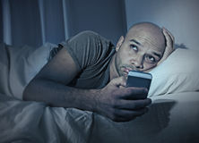 Free Young Cell Phone Addict Man Awake At Night In Bed Using Smartphone Stock Image - 45794411