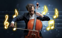 Young cellist with music sheet stock image