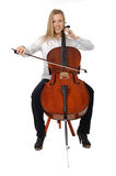 Young cellist playing. Young cellist siting and playing cello pon white background stock photo