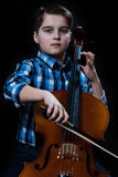 Young Cellist playing classical music on cello. Young boy Cellist playing classical music on cello royalty free stock image