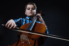 Young Cellist playing classical music on cello royalty free stock photography