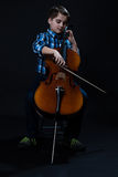 Young Cellist playing classical music on cello Stock Photography