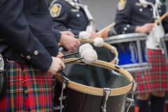 Young celtic drummers kilts closeup. Orchestra performing Saint Patrick`s day kilts royalty free stock image