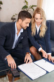 Young CEO with blonde assistant review financial results Stock Images