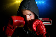 Young champion. Young boxer with ring background Royalty Free Stock Image
