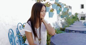 Pensive beautiful model at table stock video footage