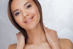Young charming brunette smiling. Beauty portrait of a young beautiful woman. royalty free stock image