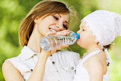 Young charming caring mother gives Stock Image