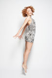 Young charming female in dress jumping Stock Photography