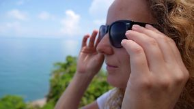 Young Charming Female Smiling Wearing Sunglasses stock footage