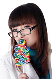 Young charming girl with candy Royalty Free Stock Image