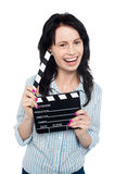 Young charming girl holding clapperboard Royalty Free Stock Photos