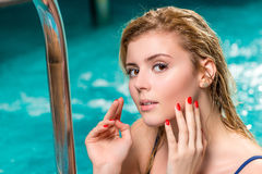 Young charming girl model in the pool. Portrait Royalty Free Stock Images