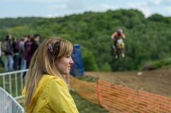 Young charming girl spectator fan at motocross competitions stock photo